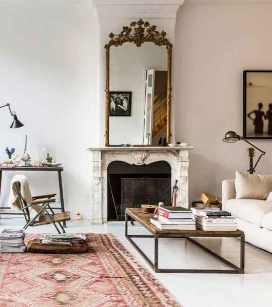 A fireplace mantel in a modern room can really become a focal point if  there's a single, ornate, antique piece placed on it. - How To Mix Antique And Modern Furniture – Louisville Mercantile